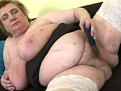 Mikaela M  (53)   obese older damsel with enormous green bazookas